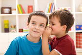 Two boys sharing a secret — Stock Photo