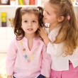 You will not believe this - little girls whispering secrets — Stock Photo