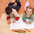 Stock Photo: Happy kids coloring tale book