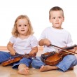 Little boy and girl with violins — Stock Photo