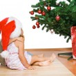 Kids looking at the christmas tree hugging — Stock Photo
