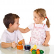 Kids dyeing the easter eggs — Stock Photo #6430130