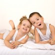 Kids having fun lazying in the bed — Stock Photo #6430135