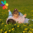 Kids wrestling on the flower field — Stock Photo