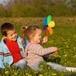 Kids playing on the spring flower field — Stock Photo