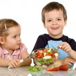 Kids eating fruit salad — Stock Photo