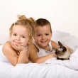 Happy kids with their kitten — Stock Photo