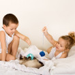 Kids playing with their kitten — Stock Photo #6430181