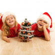 Happy kids on the floor at christmas time — Stock Photo