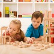 Kids inspecting their wooden block buildings — Stock Photo
