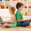 Stock Photo: Kids with laptops - computer generation