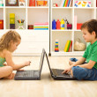 Stock Photo: Kids playing computer games