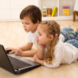 Kids busy and concentrated working on a laptop — Stock Photo