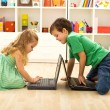 Kids playing on laptops — Stock Photo #6430256