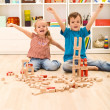 Kids proud of their wooden block buildings — Stock Photo