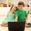 Kids with laptop, sitting on the floor — Stock Photo #6430264