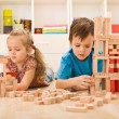 Kids playing with wooden blocks — Stock Photo