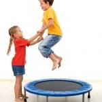 Kids having fun on a trampoline — Stock Photo