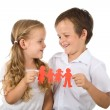 Happy smiling kids holding paper - isolated — Stock Photo
