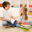 Let me tell you about school little sister — Stock Photo #6430307