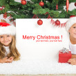 Kids laying under the christmas tree — Stockfoto