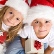 Kids with their christmas presents presents - Stock Photo
