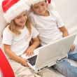 Kids searching for christmas presents online — Stock Photo #6430326