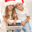 Kids with laptop ordering christmas presents — Stock Photo #6430327