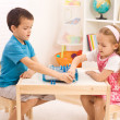 Siblings playing chess in the kid's room — Stockfoto