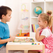 Kids playing board game in their room — Foto Stock