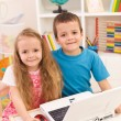 Siblings with laptop computer in their room — Stock Photo #6430351