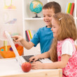 Kids playing on laptop computer at home — Stock Photo #6430355