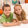 Little boy and girl listening to music together — Stockfoto