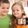 Say cheese - kids taking a photo of themselves — Stock fotografie