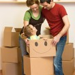 Happy family moving into a new home — Stock Photo