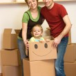 Happy family unpacking in a new home — Stock Photo