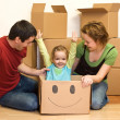 Happy family unpacking in their new home — Stock Photo