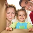 Happy family looking through a cardboard box — Stock Photo