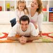 Happy family in the kids room — Stock Photo