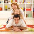 Happy casual family at home — Stock Photo