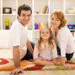 Happy family together sitting on the floor — Stock Photo #6430443