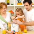 Stock Photo: Family making fresh fruit juice together