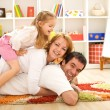 Happy family heap - parents and a kid having fun — Stock Photo