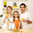 Healthy family drinking juice made from fresh fruits — Stock Photo