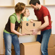 Stock Photo: Happy family with a kid moving into a new home