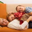 Stock Photo: Happy woman and kids having fun indoors