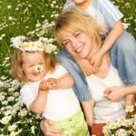 Happy outdoors spring family — Stock Photo