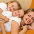 Woman playing with kids — Stock Photo