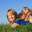 Woman and her kids playing outdoors — Stock Photo