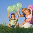 Kids and woman with balloons outdoors — Stock Photo